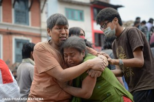 A Nepalese man and woman hold each other in Kathmandu's Durbar Square, a UNESCO World Heritage Site that was severely damaged by an earthquake on April 25, 2015. A massive 7.8 magnitude earthquake killed hundreds of people April 25 as it ripped through large parts of Nepal, toppling office blocks and towers in Kathmandu and triggering a deadly avalanche that hit Everest base camp. AFP PHOTO / PRAKASH MATHEMA